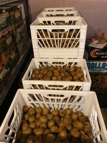 Crates of kiwi fruit.