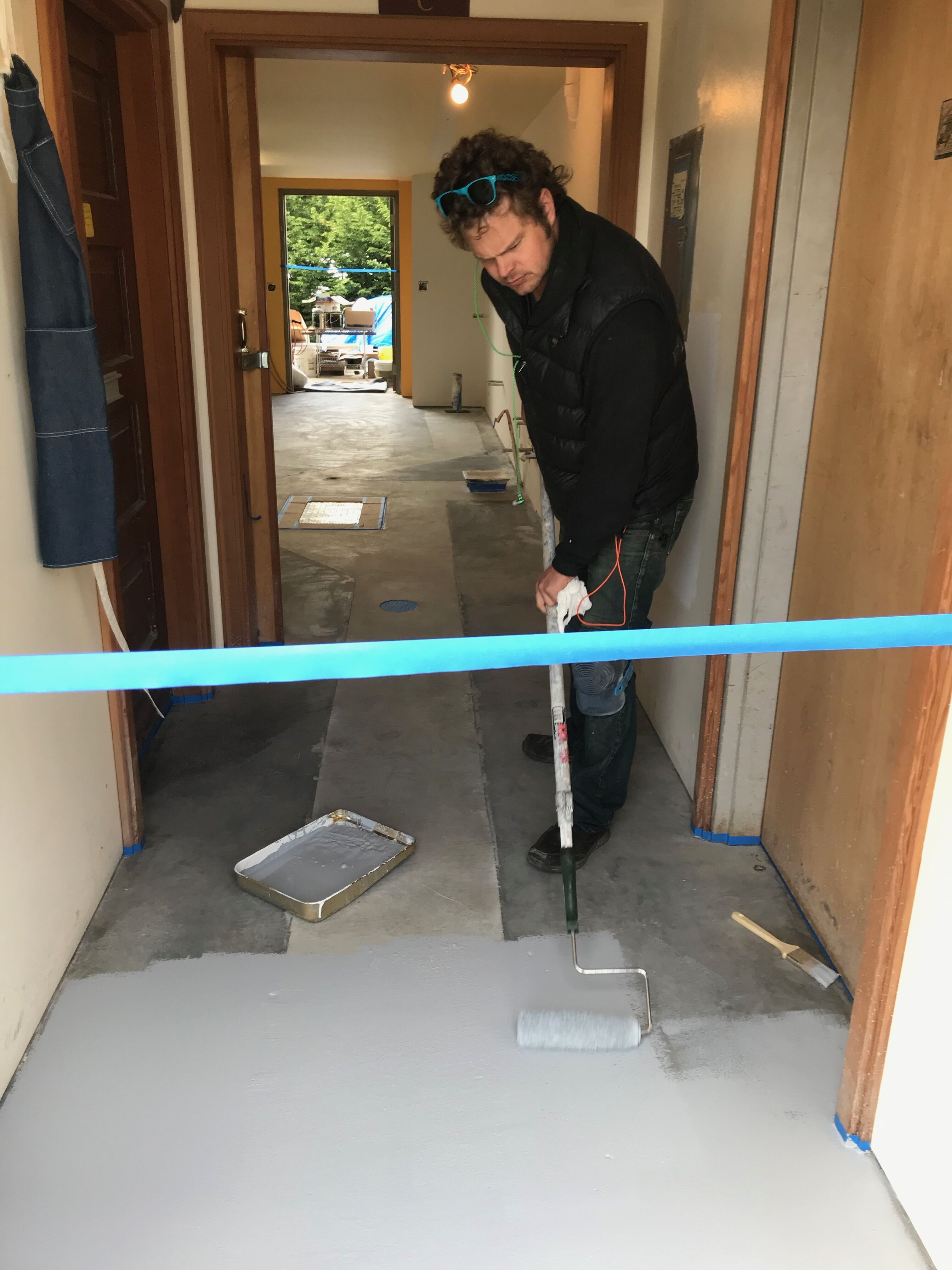 Ted Warner applying the floor.